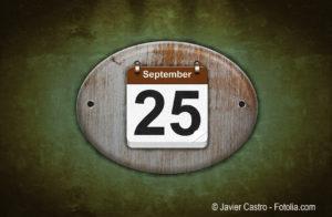 Old wooden calendar with September 25.